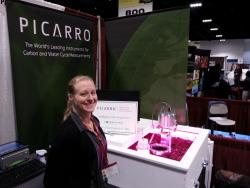 Gloria in the Picarro booth at the SSSA meeting in Tampa